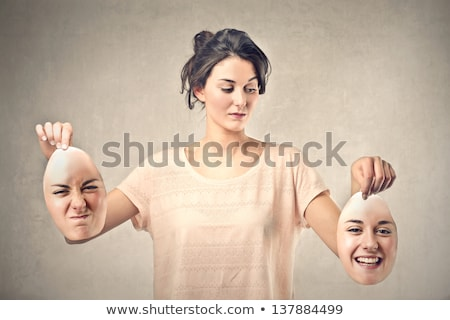 Stock photo: beautiful girl holds two masks