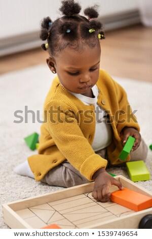 jogar · jardim · brinquedos · família · grama · feliz - foto stock © dariazu