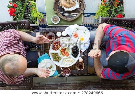 Iki erkekler dua eden gıda tadını çıkarmak sağlıklı Stok fotoğraf © ozgur