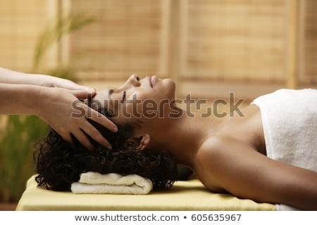 beautiful brunette enjoying a head massage stock photo © wavebreak_media