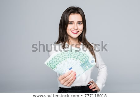 happy businesswoman holding 500 euro banknotes stock photo © juniart