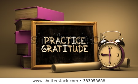 Practice Gratitude Handwritten on a Blackboard. Stock photo © tashatuvango
