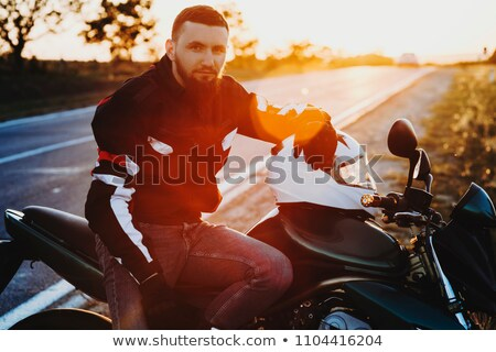 motorcyclist sitting on country road near bike Stock photo © Paha_L