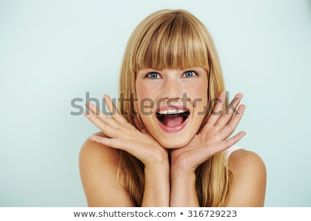 Surprised young woman with a long fringe Stock photo © konradbak