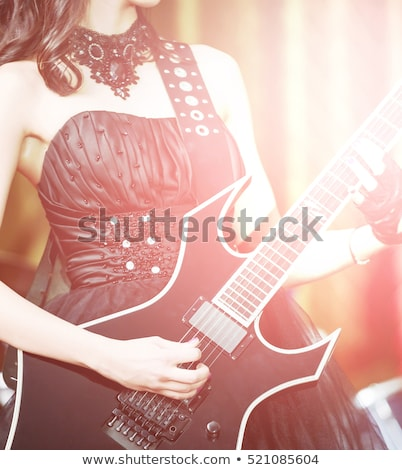 Close-up of girl with black electro guitar  stock photo © Elisanth