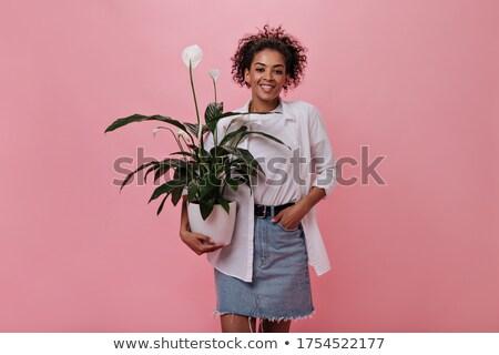 Csinos lány fekete szoknya virágok izolált Stock fotó © Elnur