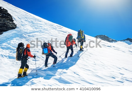 Stock photo: Rock climbing team reaching the summit.