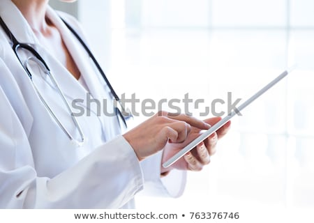 female doctor working with tablet computer stock photo © dashapetrenko