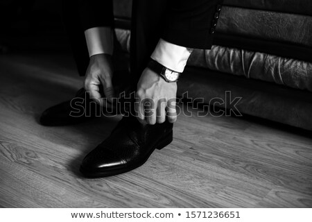 Handsome groom on his wedding day - tying a shoe lace Stock photo © lightpoet