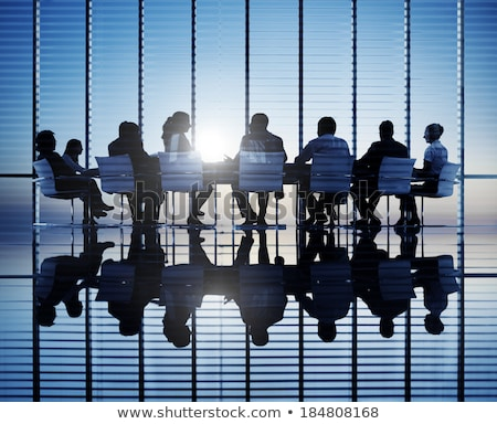 businesspeople working together on business meeting in conference room stock photo © deandrobot