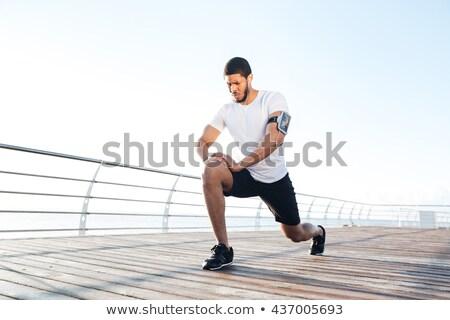 Izmos afrikai férfi atléta felfelé testmozgás Stock fotó © deandrobot