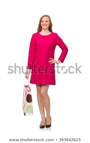 Shopper girl in pink dress holding plastic bags isolated on whit Stock photo © Elnur