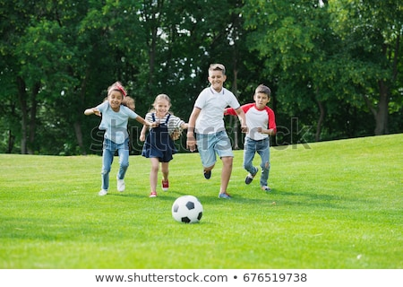 Boys and girls playing in the park Stock photo © bluering