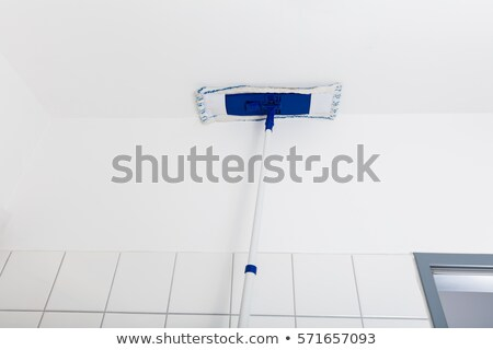 Mop Wiping On The Ceiling Of The Bathroom Stock photo © AndreyPopov