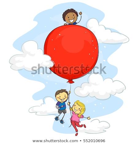kids riding on big balloon stock photo © bluering