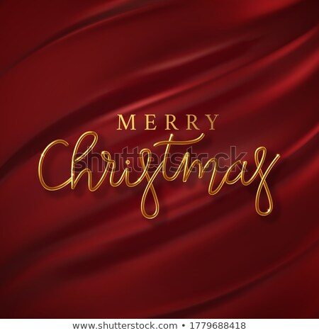 golden merry xmas lettering on red silk background Stock photo © SArts