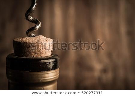 Vin rouge bouteille tire-bouchon pierre haut vue Photo stock © karandaev