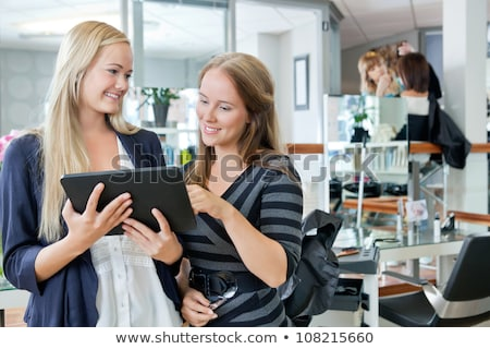 Female with tablet in parlour Stock photo © dash