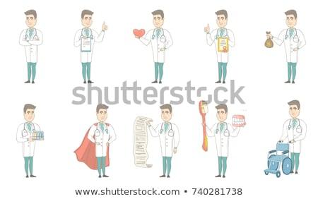 Caucasian doctor holding a money bag. Stock photo © RAStudio