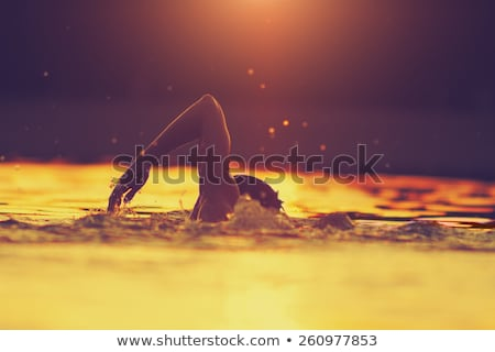 young athlete swimming in the ocean stock photo © konradbak