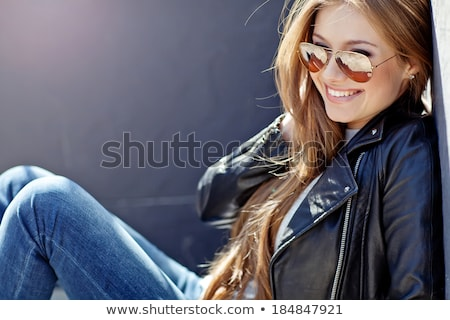 glamorous young woman in black leather jacket stock photo © tekso