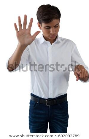 Tizenéves fiú kisajtolás láthatatlan virtuális képernyő fehér Stock fotó © wavebreak_media