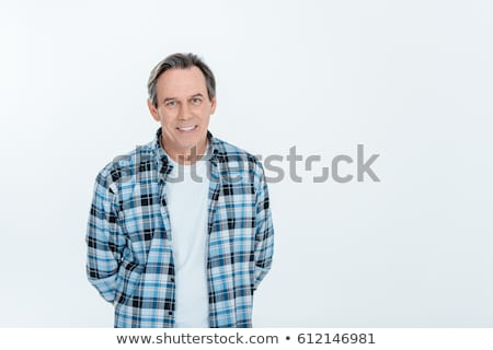 Front view of middle aged handsome man smiling on white with copy space Stock photo © LightFieldStudios