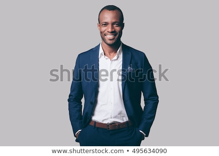 Cheerful young man dressed in formalwear Stock photo © deandrobot