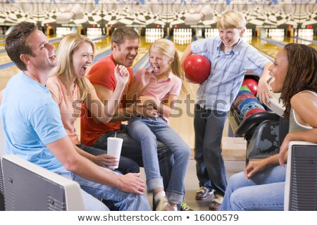 Family in bowling alley smiling Stock photo © monkey_business