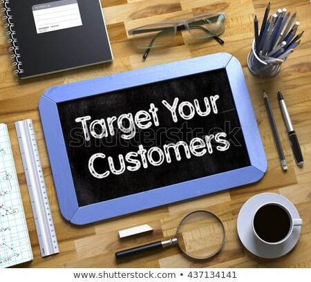 Handwritten Target Your Customers on a Chalkboard. Stock photo © tashatuvango