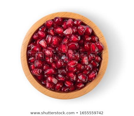 bowl of pomegranate seeds stock photo © digifoodstock
