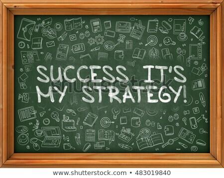 hand drawn success its my strategy on green chalkboard stock photo © tashatuvango