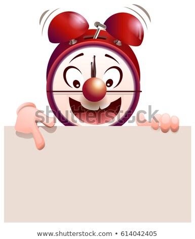 Funny alarm clock hold and shows blank sheet Stock photo © orensila