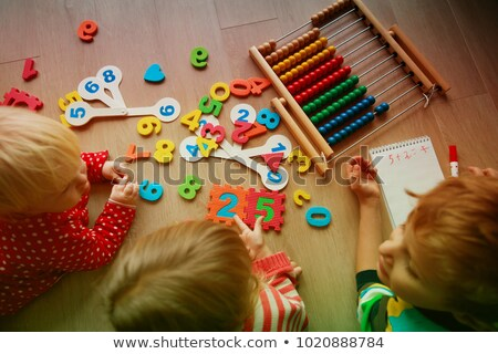 brother and sister playing with abacus Stock photo © IS2