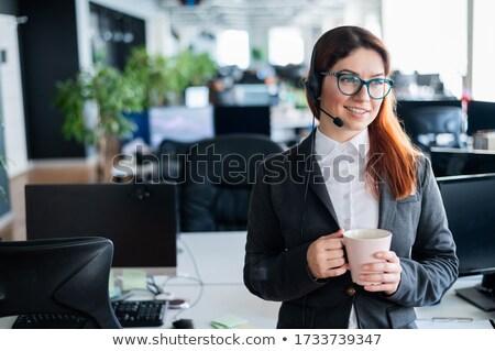 деловая женщина гарнитура улыбаясь компьютер технологий Сток-фото © IS2
