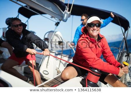 Femme voile yacht amusement souriant lunettes de soleil Photo stock © IS2