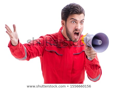 Young repairman with a megaphone bullhorn isolated on white back Stock photo © Elnur