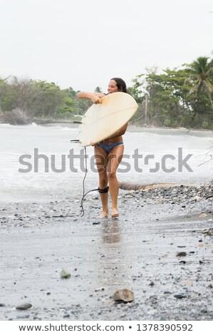 Kadın bikini yürüyüş aşağı plaj yaz tatili Stok fotoğraf © Kzenon