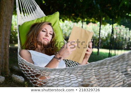Woman relaxing in shade Stock photo © IS2
