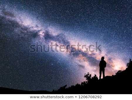 Space, Milky Way, silhouette of a woman with backpack Stock photo © denbelitsky