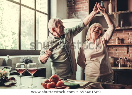 senior couple with glasses of wine stock photo © is2