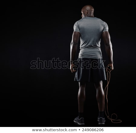 Back view of a healthy strong male bodybuilder standing Stock photo © deandrobot