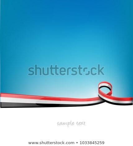yemen sahara ribbon flag on blue sky background stock photo © doomko