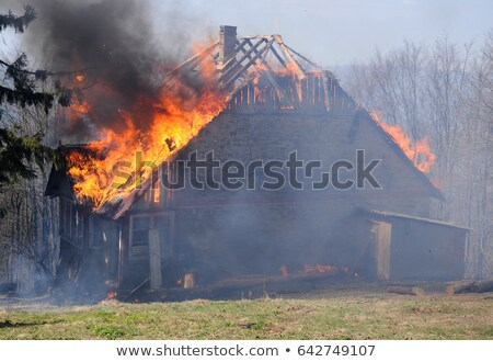 Stockfoto: Burning Fire Flame On Wooden House Roof