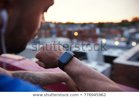 Runner standing on urban rooftop Stock photo © IS2