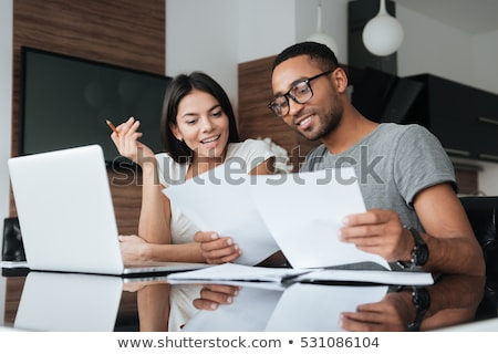 Woman looking at home finances Stock photo © IS2