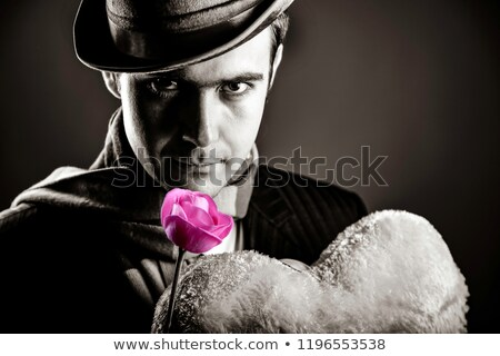 Mysterious men with toy and rose Stock photo © Massonforstock