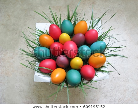 Easter eggs in basket at green grass blades of grass Stock photo © Wetzkaz