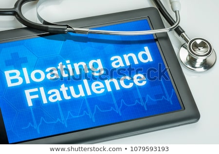 Tablet with the text Bloating and Flatulence on the display Stock photo © Zerbor