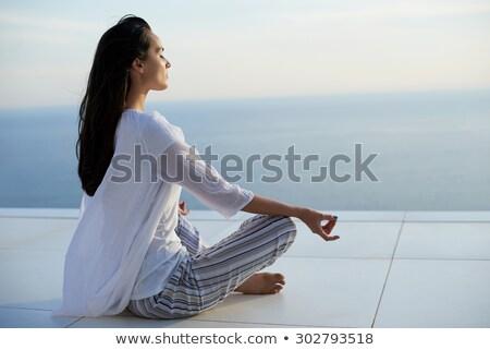 Gyönyörű lány pózol erkély szexi fürtös lány Stock fotó © bezikus